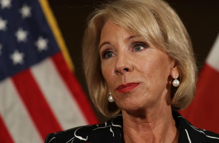 Betsy DeVos sued for seizing wages from student loan debtors throughout pandemic