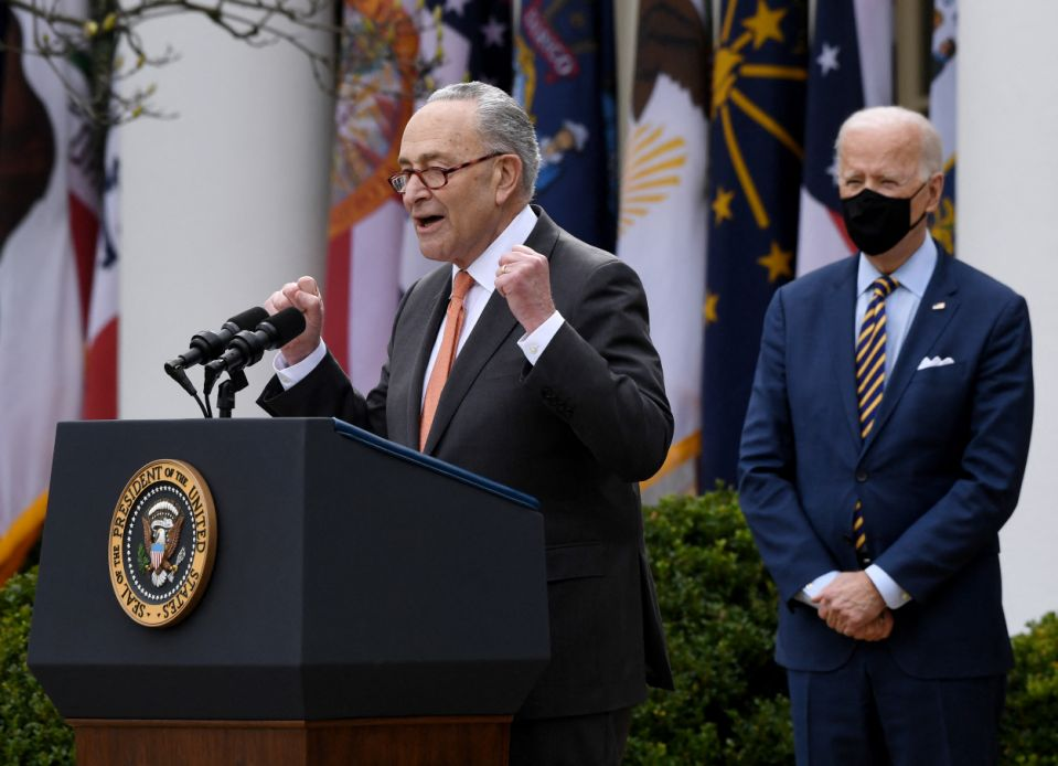 US President Joe Biden (R) listens as US Senate Majority Leader Senator Chuck Schumer (D-NY) during an event on the American Rescue Plan in the Rose Garden of the White House in Washington, DC, on March 12, 2021. (Photo by OLIVIER DOULIERY / AFP) (Photo by OLIVIER DOULIERY/AFP via Getty Images)