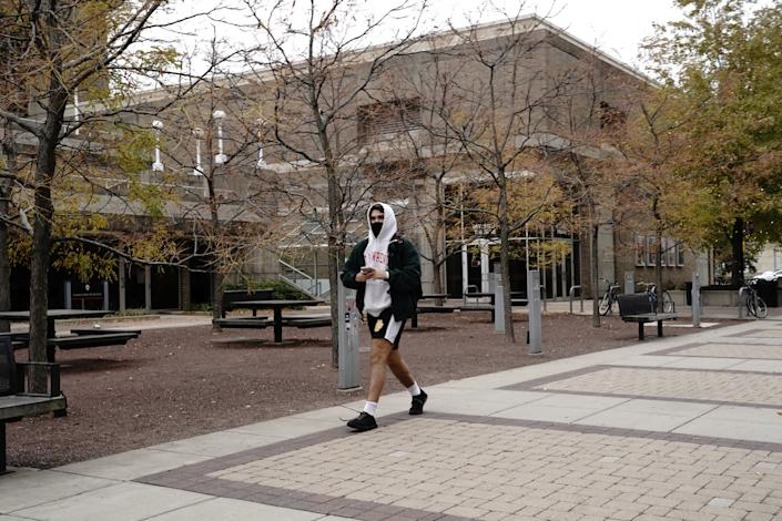 A student wearing a protective mask walks on the campus of the University of Wisconsin-Madison, as the coronavirus disease (COVID-19) outbreak continues in Madison, Wisconsin, U.S., October 19, 2020. (Bing Guan/Reuters)