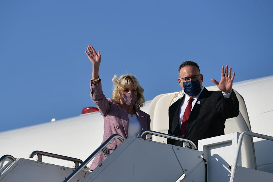 US First Lady Jill Biden and Education Secretary Miguel Cardona arrive at Erie International Airport in Erie, Pennsylvania, on March 3, 2021. - Biden and Cardona will tour Fort LeBoeuf Middle School in Waterford, Pennsylvania. (Photo by MANDEL NGAN / POOL / AFP) (Photo by MANDEL NGAN/POOL/AFP via Getty Images)